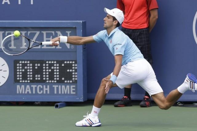 Novak Djokovic affronteraDiego Schwartzman lors de son premier... (PHOTO AL BEHRMAN, AP)