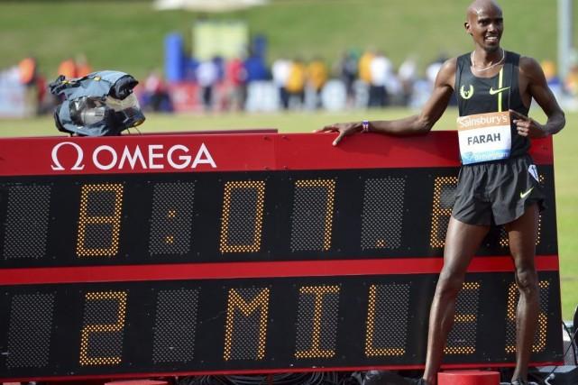 Mo Farah, âgé de 31 ans, a complété... (PHOTO CARL COURT, AFP)
