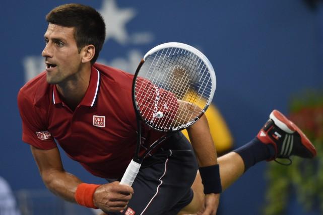 Le N.1 mondial Novak Djokovic n'a eu besoin que d'1 h 37 minutes pour décrocher... (Photo DON EMMERT, AFP)