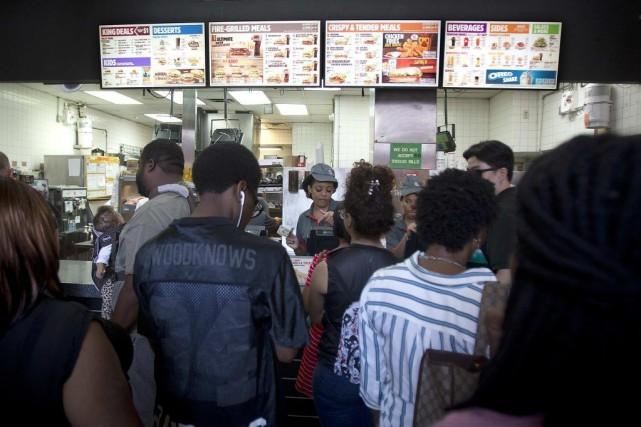 Le titre de Burger King a plus que... (PHOTO CARLO ALLEGRI, REUTERS)