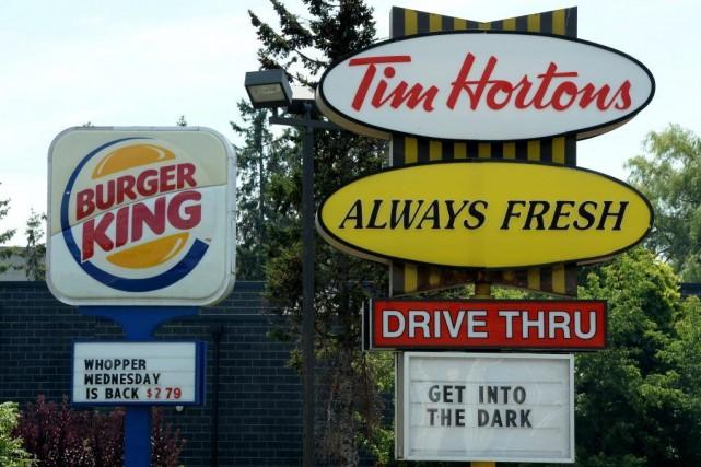 Tim Hortons et Burger Kingcontinueront à fonctionner en... (Photo Sean Kilpatrick, PC)