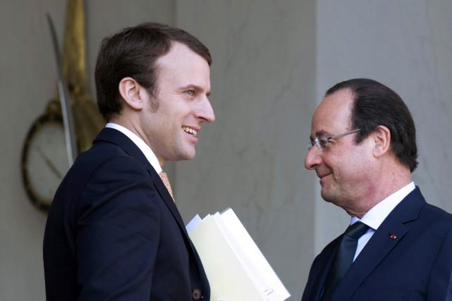 Emmanuel Macron (à gauche) et François Hollande (à... (PHOTO ALAIN JOCARD, ARCHIVES AFP)