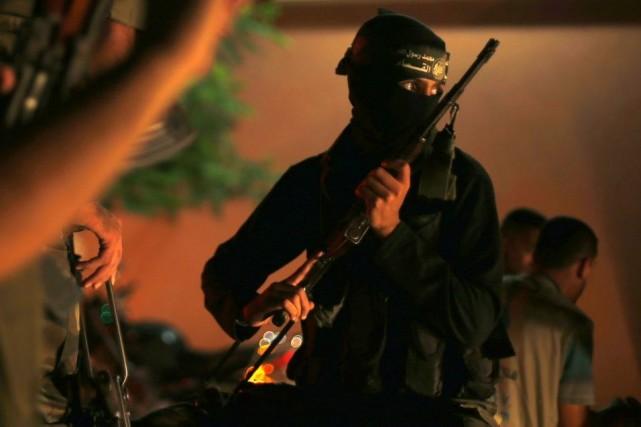 Un combattant du Hamas.M. Baird a exhorté l'organisation... (Photo Reuters)