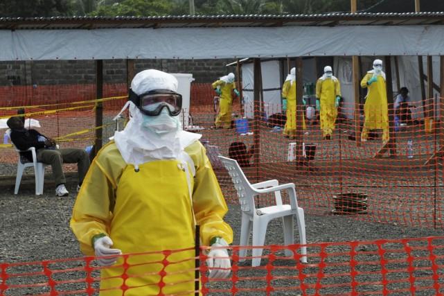 Le virus a fait au total 1427 morts,... (Photo REUTERS)