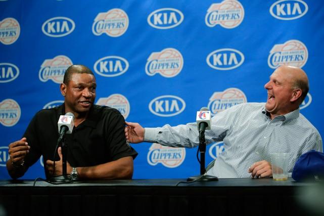 L'entraîneur des Clippers de Los Angeles, Doc Rivers,... (Photo Jae C. Hong, AP)