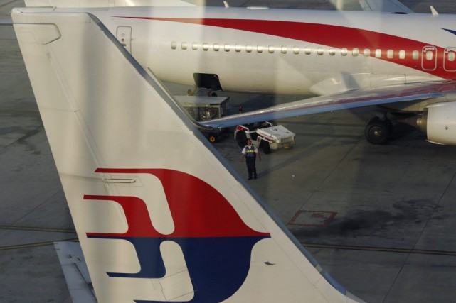 Le Boeing 777 de Malaysia Airlines s'est volatilisé le 8 mars 2014... (PHOTO OLIVIA HARRIS, ARCHIVES REUTERS)
