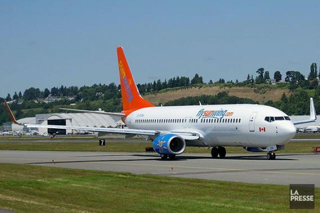 Un avion de la compagnie Sunwing... (Archives La Presse)