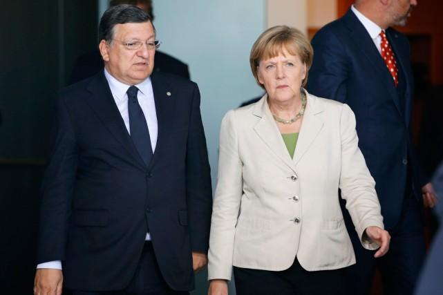 La chancelière allemande Angela Merkel et le président... (Photo Fabrizio Bensch, Reuters)
