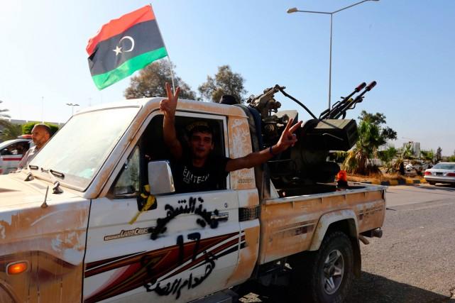 Un membre d'une milice islamiste à Tripoli, le... (PHOTO MAHMUD TURKIA, ARCHIVES AGENCE FRANCE-PRESSE)
