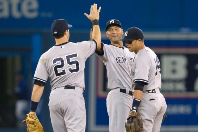 Derek Jeter, Mark Teixeira et Martin Pradodes Yankees... (Photo Fred Thornhill, La Presse Canadienne)