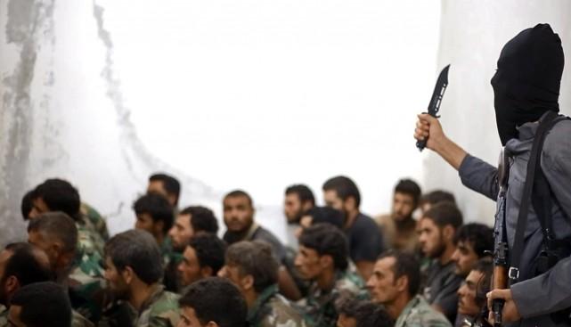 Faut-il que les démocraties paient pour libérer leurs... (Photo Associated Press/Raqqa Media Center)