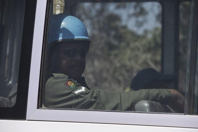 Des rebelles syriens ont formulé trois conditions pour libérer les 45 Casques... (Photo BAZ RATNER, Reuters)