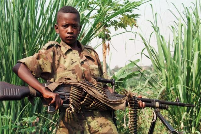 Des enfants sont enrôlés dans des mouvements rebelles,... (PHOTO ABDELHAK SENNA, ARCHIVES AGENCE FRANCE-PRESSE)
