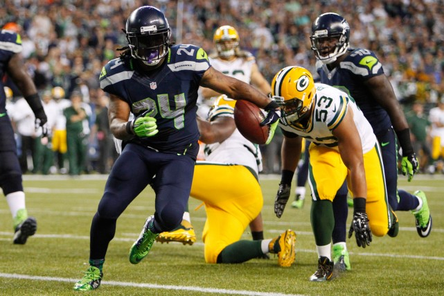Marshawn Lynch a inscrit deux touchés dans la... (Photo Joe Nicholson, USA Today)