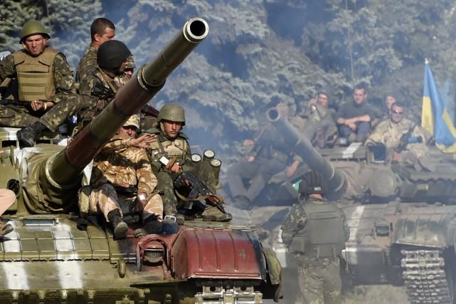 Kiev et les séparatistes prorusses ont annoncé hier... (Photo PHILIPPE DESMAZES, agence france-presse)