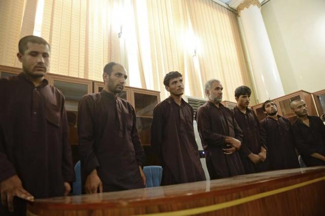 Les sept accusés peuvent encore interjeter appel de... (PHOTO SHAH MARAI, AFP)