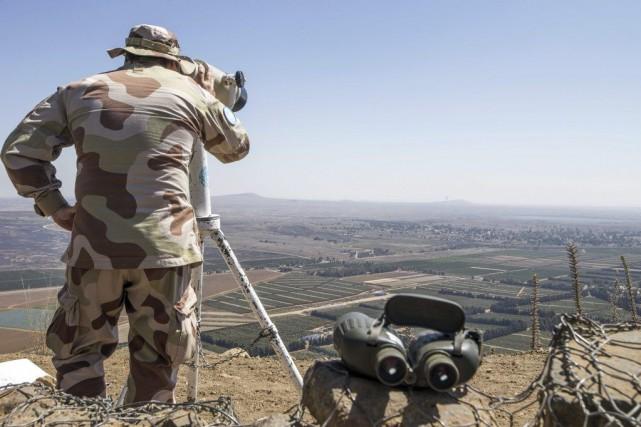 Les combats font rage à Qouneitra sur le... (PHOTO JACK GUEZ, AFP)