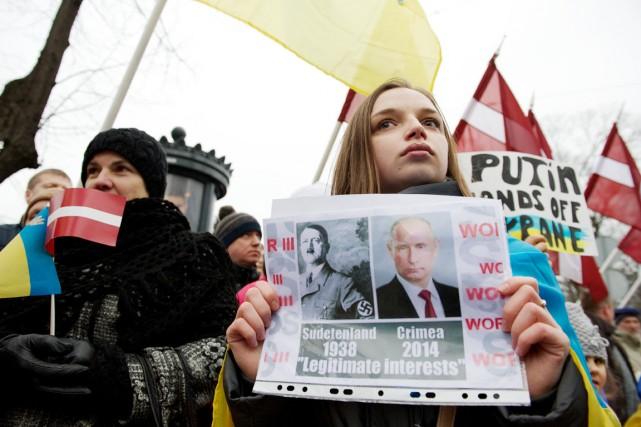 Lors d'une manifestation en Lettonie en mars, une... (PHOTO ILMARS ZNOTINS, ARCHIVES AFP)
