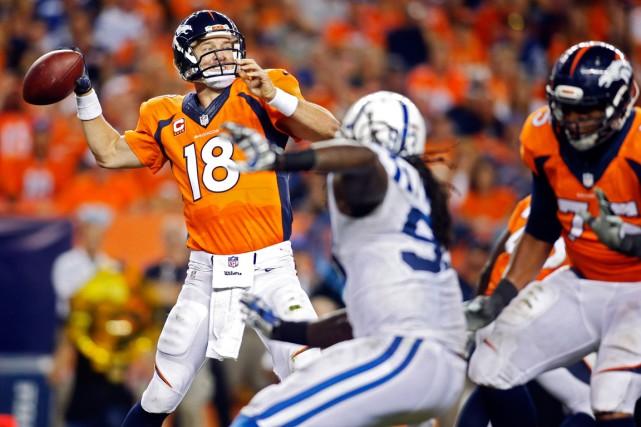 Peyton Manning a lancé trois passes de touché... (Photo Chris Humphreys, USA Today)