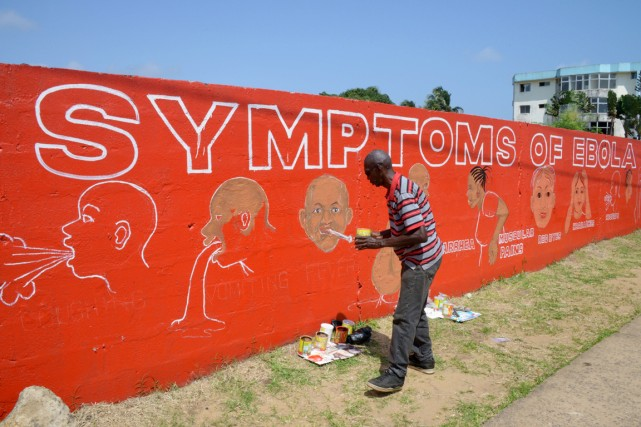 Stephen Doe, un artiste de rue de Monrovia... (PHOTO DOMINIQUE FAGET, AFP)