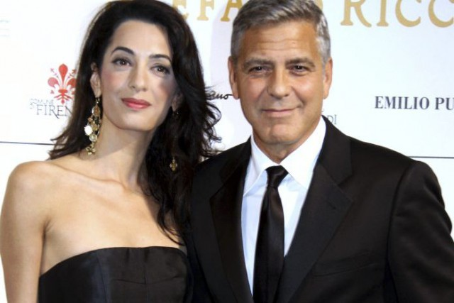 George Clooney et sa fiancée Amal Alamuddin.... (PHOTO ARCHIVES AFP)