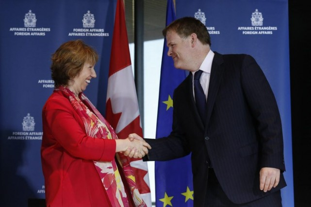 Catherine Ashton et John Baird... (PHOTO CHRIS WATTIE, REUTERS)