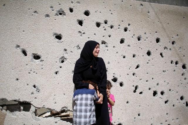 L'enclave côtière, où 1,8 million de Palestiniens s'entassent... (Photo SAID KHATIB, AFP)