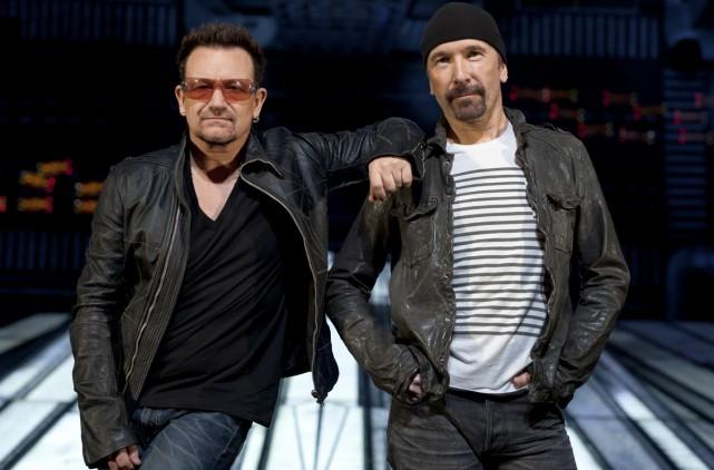 Le groupe U2, notamment Bono et The Edge,... (Photo: The New York Times)