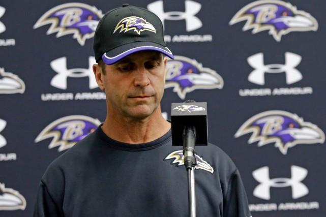 L'entraîneur-chef des Ravens de Baltimore John Harbaugh et... (Photo Patrick Semansky, AP)