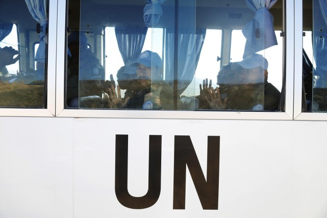Un important convoi de l'ONU traversait à la... (PHOTO BAZ RATNER, REUTERS)