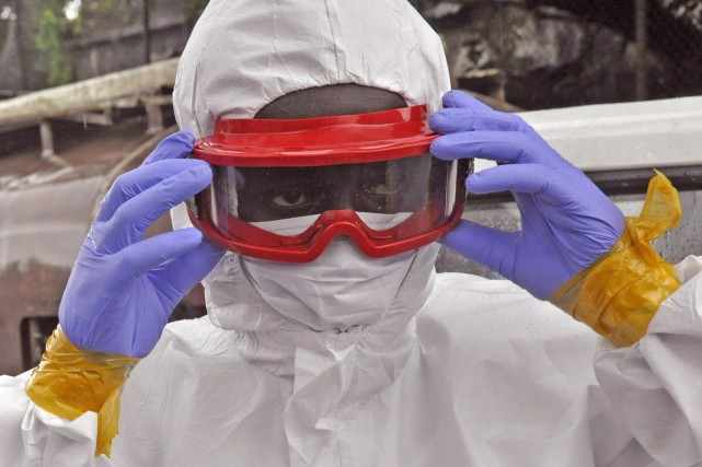 La prévention de la transmission du virus Ebola... (Photo Abbas Dulleh, AP)