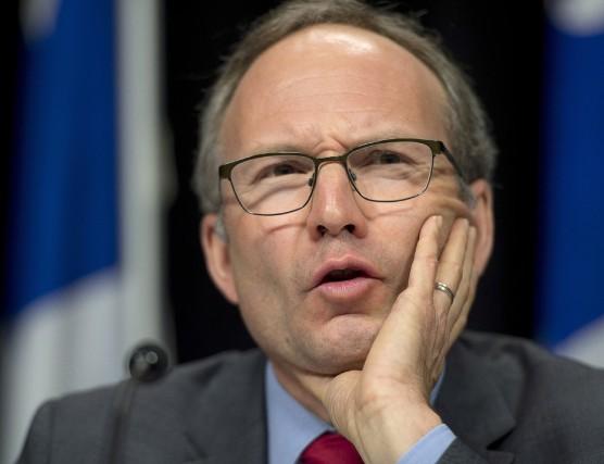 Martin Coiteux, le président du Conseil du trésor.... (Photo Jacques Boissinot, La Presse Canadienne)