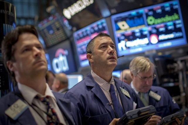 «Les investisseurs avancent à tout petits pas avant... (PHOTO BRENDAN MCDERMID, REUTERS)