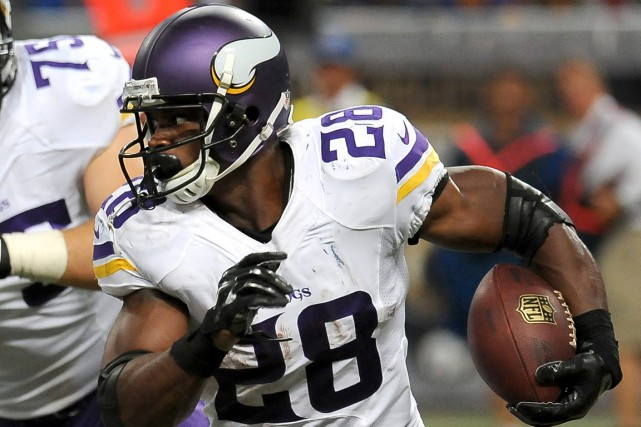 Adrian Peterson... (Photo L.G. Patterson, archives AP)