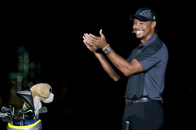 Tiger Woods... (Photo Mel Evans, archives AP)