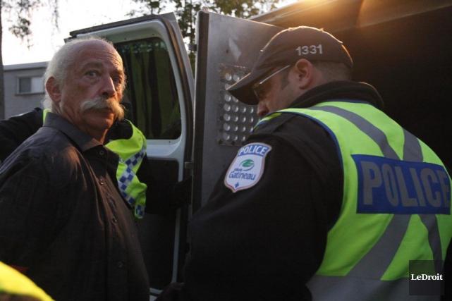 Roger Fleury, lors de son arrestation, plus tôt... (Simon Séguin-Bertrand, LeDroit)