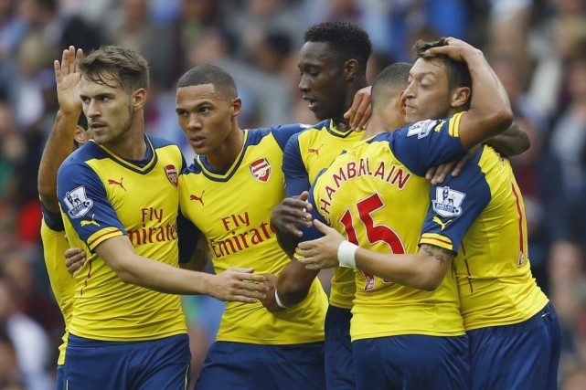 Les Gunners peuvent souffler.... (PHOTO DARREN STAPLES, REUTERS)