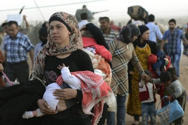 Face aux affrontements entre jihadistes et combattants kurdes... (Photo AP)