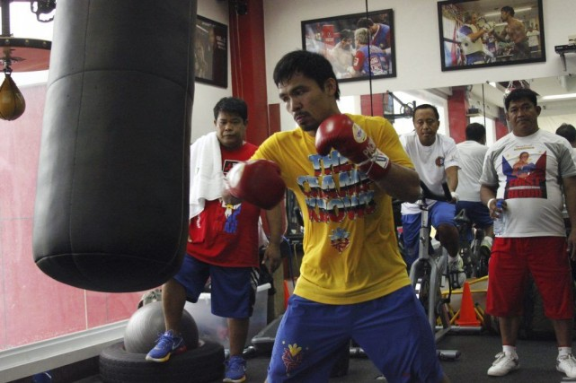 Les futurs adversaires de Pacquiao sur les parquets... (PHOTO AFP)