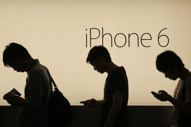 C'est un «record» pour Apple qui écoule ainsi... (Photo Vincent Yu, Reuters)