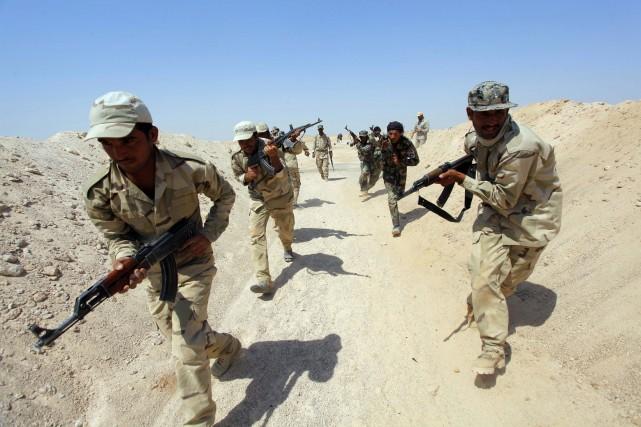 Les djihadistes de l'État islamique (EI) ont attaqué une base de l'armée... (Photo REUTERS)