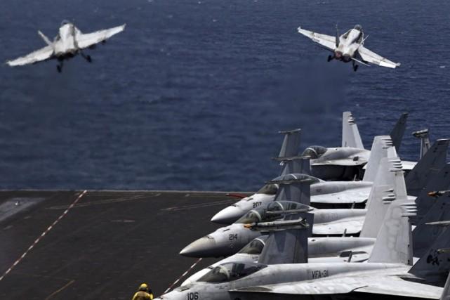 L'armée américaine et des nations «partenaires» bombardent depuis lundi soir... (Photo: AP)