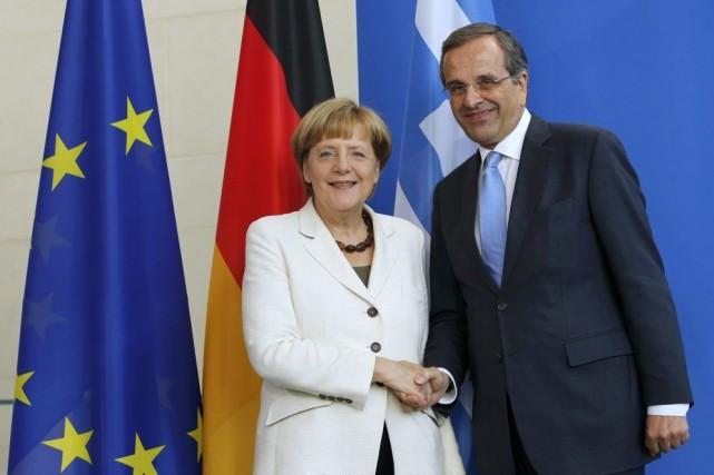 La chancelière allemande Angela Merkelet son homologue grec... (PHOTO FABRIZIO BENSCH, REUTERS)