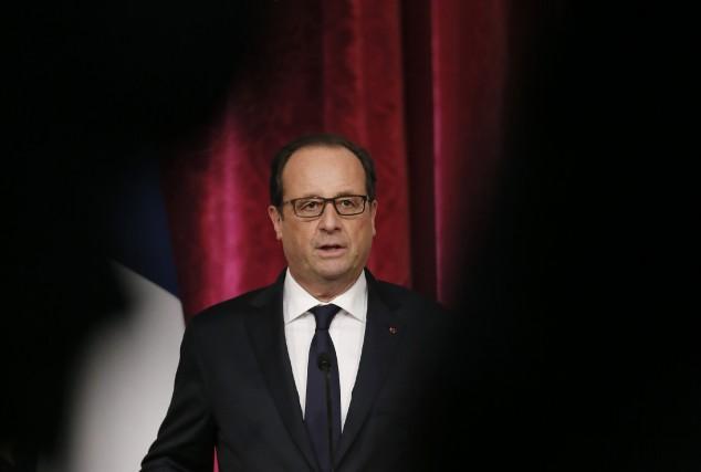 Hollande a, entre autres, assuré que la France... (Photo GONZALO FUENTES, Reuters)