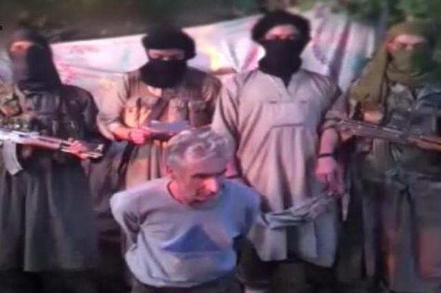 Les djihadistes de Jund al-Khilafa ont montré l'exécution... (PHOTO TIRÉE DE LA VIDÉO DIFFUSÉE PAR JUND AL-KHILAFA)