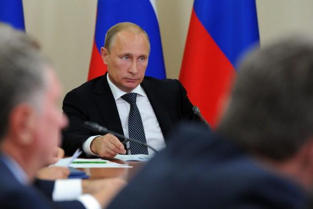 Le président russe, Vladimir Poutine... (Photo Michael Klimentyev, AP)
