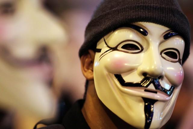 Anonymous a déclaré la guerre au groupe État... (PHOTO MOHD RASFAN, ARCHIVES AFP)