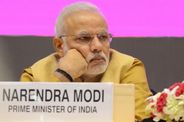Le premier ministre Narendra Modi doit atterrir vendredi... (PHOTO RAVEENDRAN, ARCHIVES AFP)