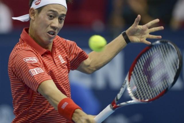 Kei Nishikori... (PHOTO MOHD RASFAN, AFP)