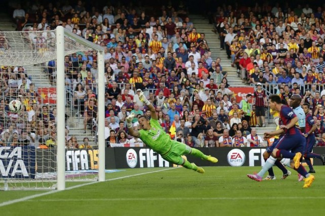 Lionel Messi a inscrit les 400e et 401e... (PHOTO GUSTAU NACARINO, REUTERS)